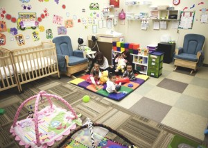 Child care staff and babies inside the playroom