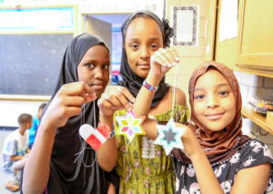 Girls posed with their projects